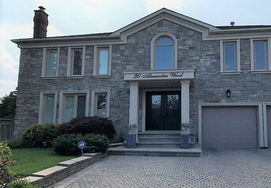 stone contractors Oakville - custom home with stone siding