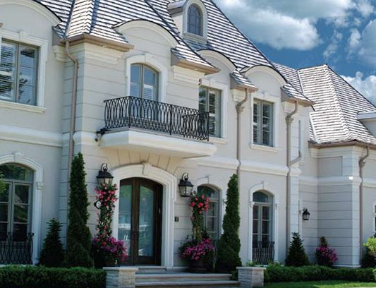 Maple luxury white stucco exterior of a house