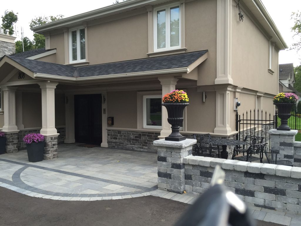 stone siding and stucco on luxury home in Oakville