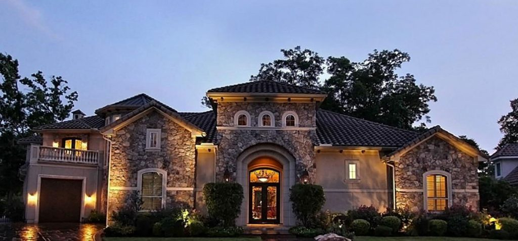 Exterior stucco design with stone siding