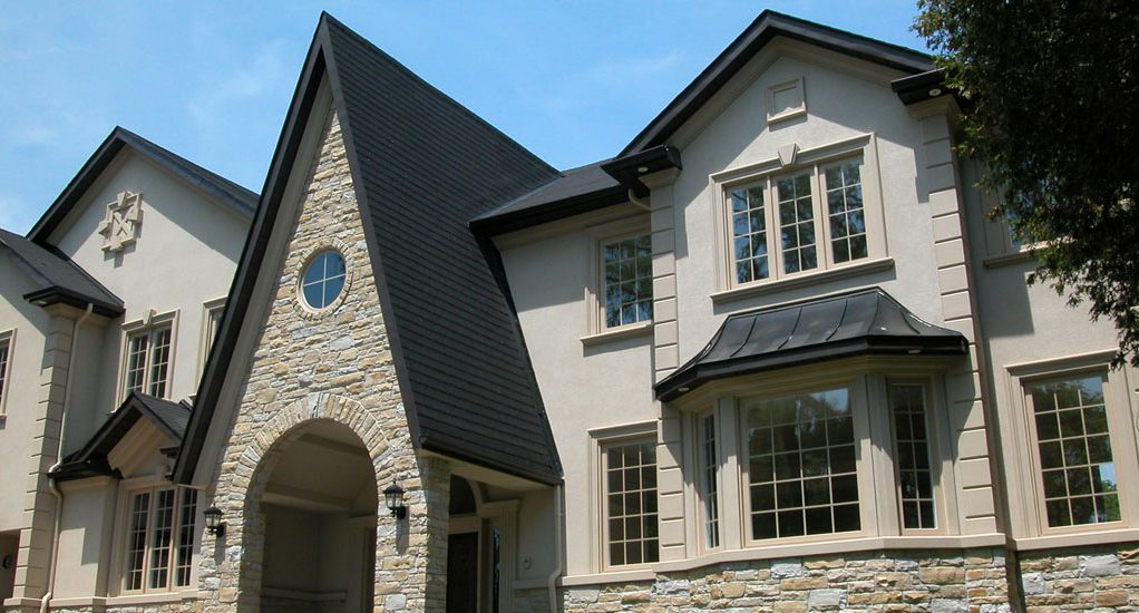 Exterior stucco stone siding installation exterior by for Stucco stone exterior designs