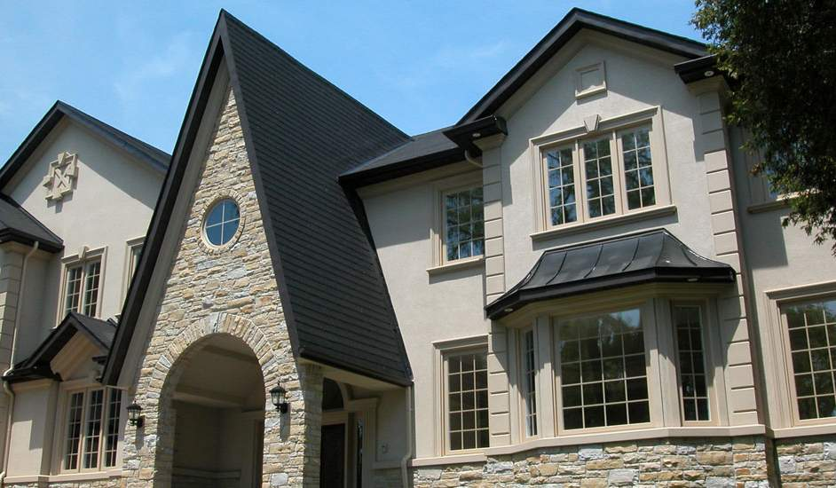 stone siding and stucco home exterior