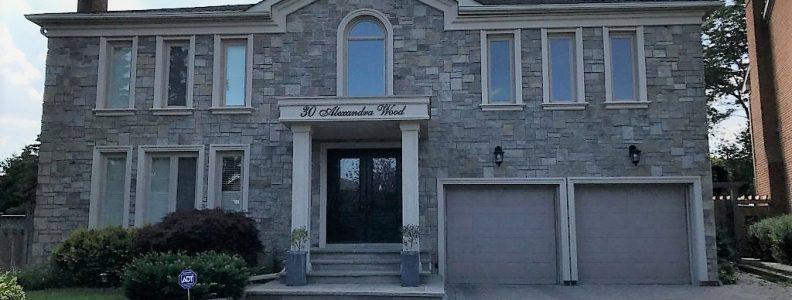 stone siding in custom home exterior, Toronto