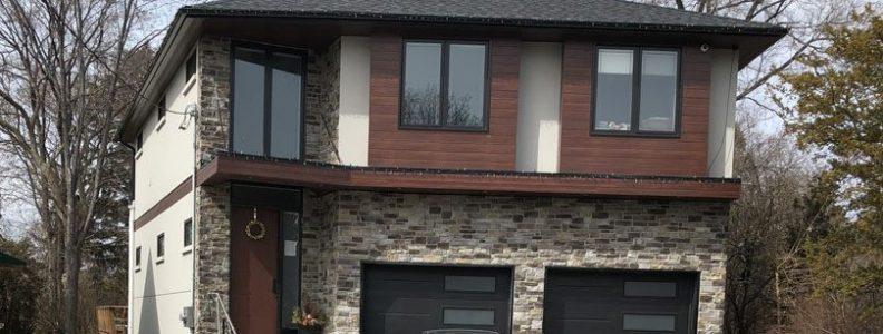luxury house with Stone siding, Maple