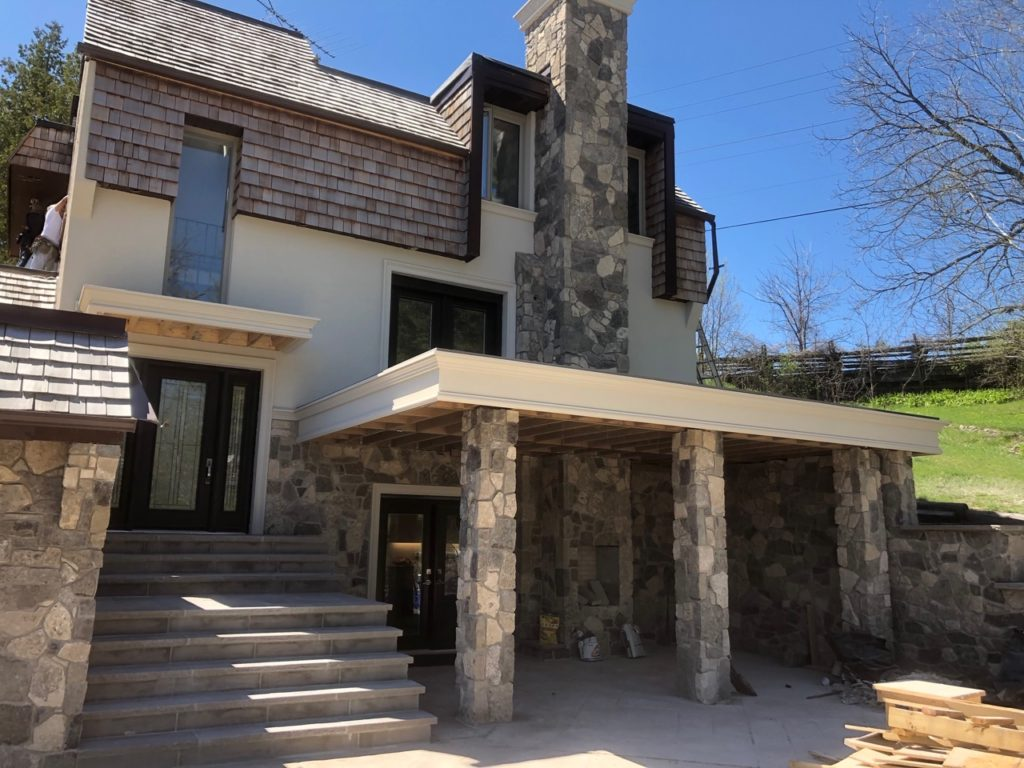 amazing custom house with stucco and stone siding