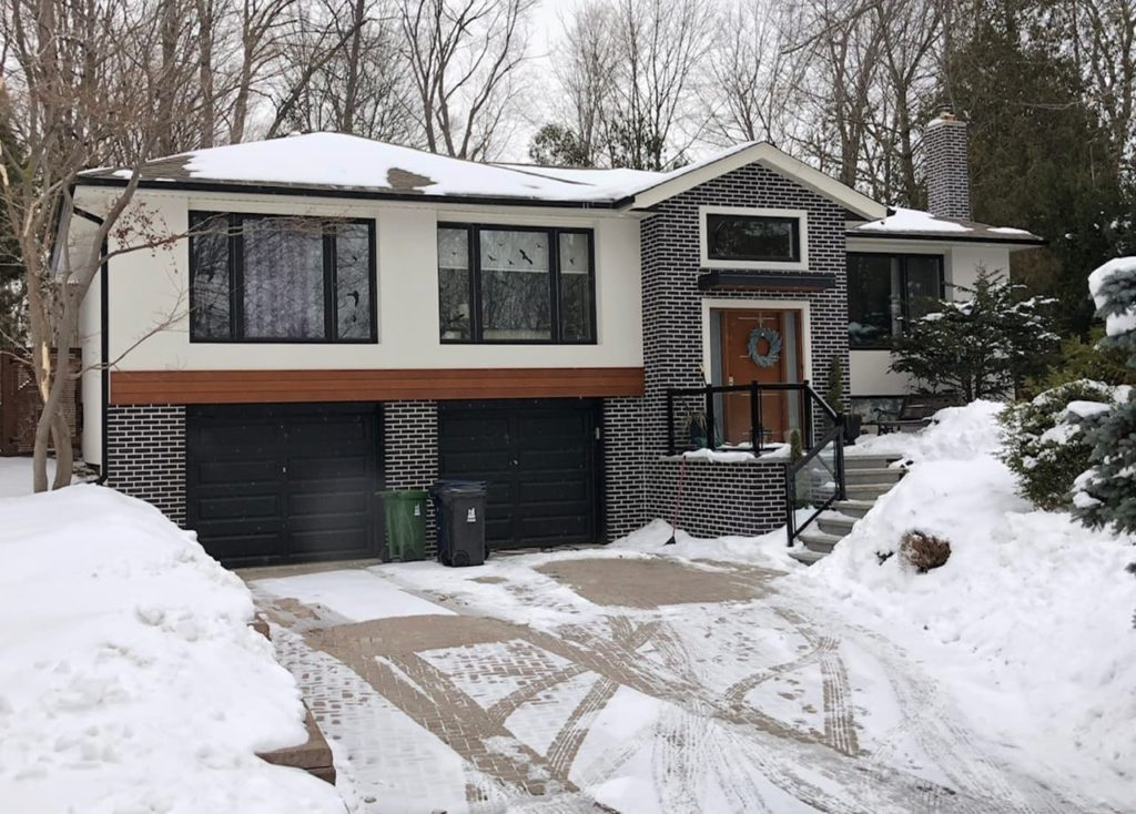 custom home with exterior stone siding