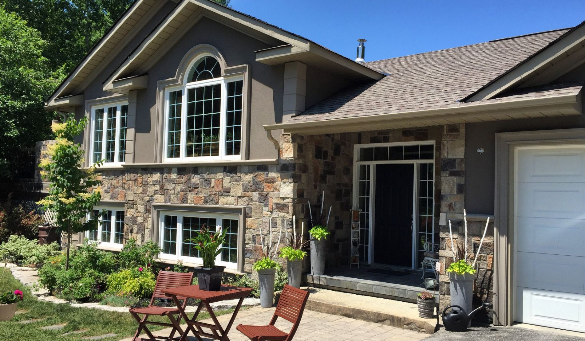 custom home with amazing stone siding and stucco