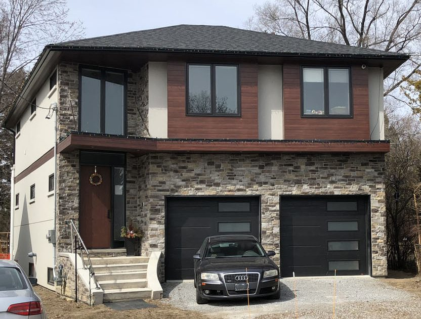 Luxury Home with Amazing Stone Siding by Exterior by Design Markham
