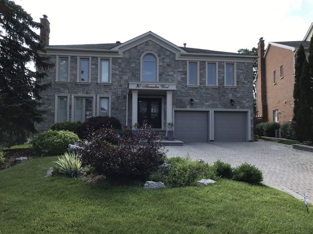 Luxury House Exterior with Stone Veneer Siding Mississauga
