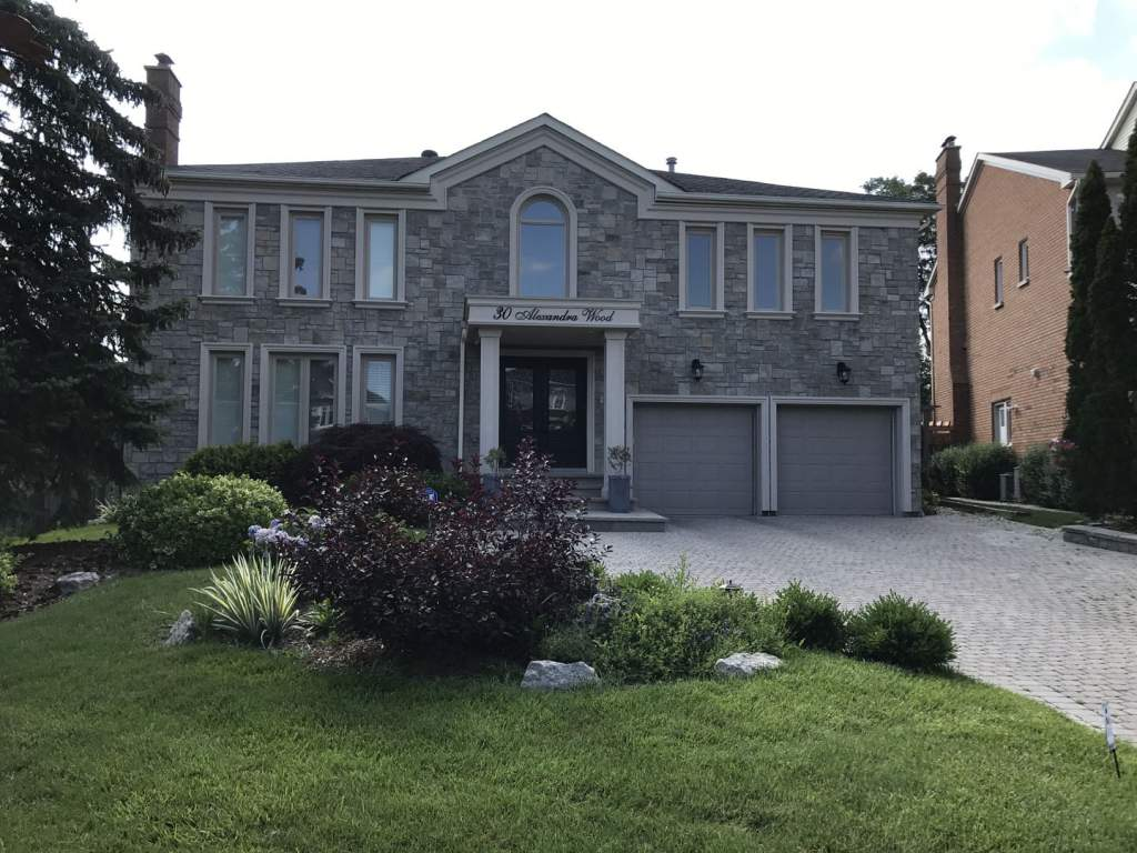 Modern Custom Home with Exterior Stone Veneer by Exterior by Design Richmond Hill