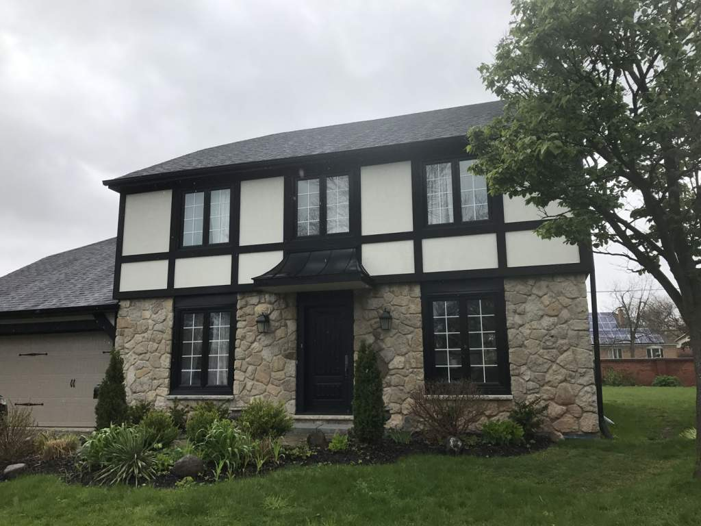Custom Home with Amazing Stone Siding and Stucco by Exterior by Design in The Beaches