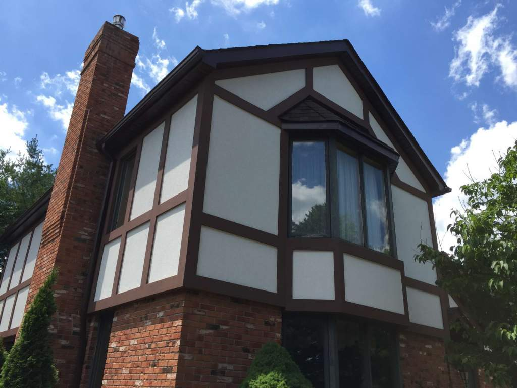 Custom Home with Exterior Stucco and Stone Veneer by Exterior by Design Mississauga